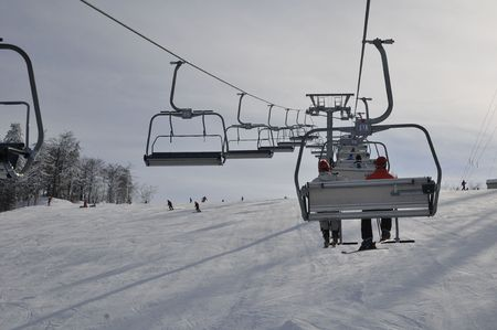 Chairlift with skier at Slovacl ski resort, photo