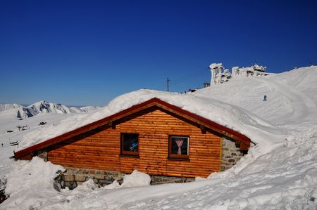 Wooden snow-covered cottage in Slovac ski centre Jasná Stock Photo - 4675130