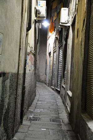 Typical narrow alley in the evening Genoa