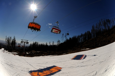 stanchion: High Tatras,Slovakia-March 2011:Chairlift in the Orange bubble