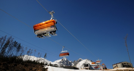 High Tatras,Slovakia-March 2011:Chairlift in the Orange bubble Stock Photo - 9286586