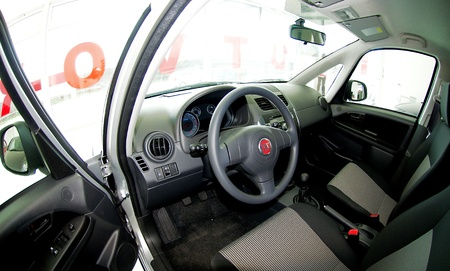 sedící: Liptovský Mikuláš,Slovakia-April 2011:Interior Fiat Sedici 4x4  . Fiat Automobiles S.p.A. is an Italian automaker which produces Fiat branded cars, and is the largest automobile manufacturer in Italy. Redakční