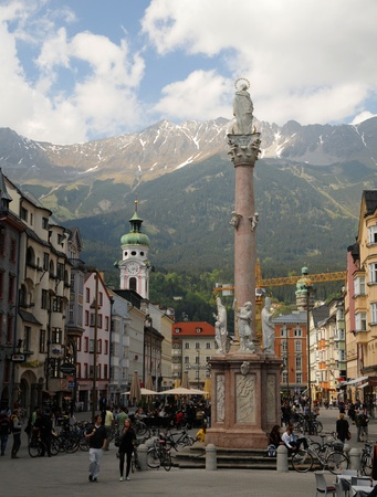 innsbruck, austria, may, 2011 - our lady statue on a column in maria theresien strasse