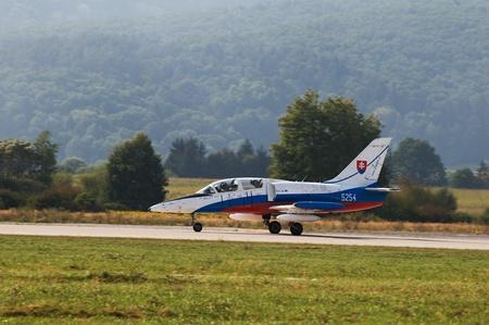 ejector: aiport sliac,slovakia august 2011:slovac international air fest siaf 2011-L-39 Albatros  slovak air force