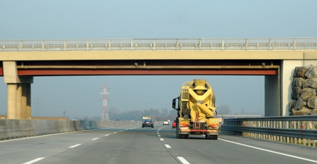 Concrete trucks on the highway under the bridge photo