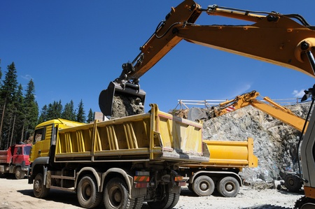 Belt excavator loading a big truck