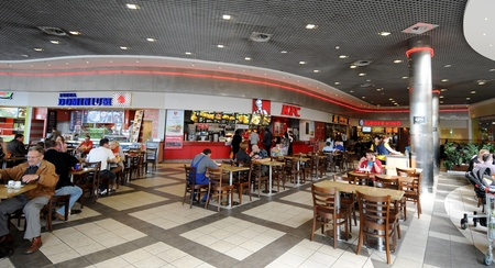 Krakow, Poland April 2012:Customers are buying fast food products inside a KFC (Kentucky Fried Chicken) restaurant, in Krakow Poland Publikacyjne