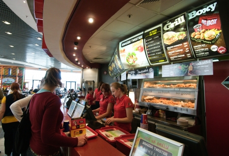Krakow, Poland April 2012:Customers are buying fast food products inside a KFC (Kentucky Fried Chicken) restaurant, in Krakow Poland