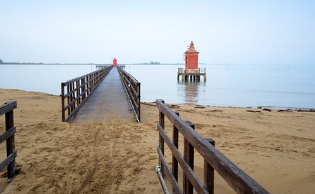 Pier with red tower - Lignano-Italy  Stock Photo