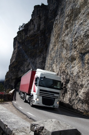 Crossing a truck on the narrow roads in the Italian Dolomites