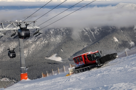 Jasna, Slovakia, Januar 2013:Modern cabin cable car in Slovak ski resort above the clouds clear Stock Photo - 18112314