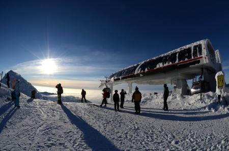 Jasna , Slovakia, Januar 2013 Modern cabin cable car in Slovak ski resort above the clouds clear