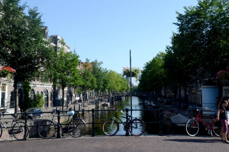 bycicle: Amsterdam Holland August 2012:Scenic Bycicle in an Amsterdam Canal Editorial