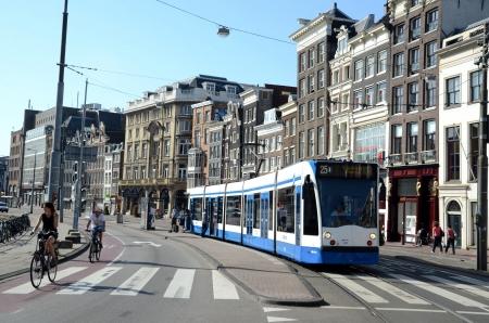 dam square: Amsterdam Holland August 2012:Tram to Dam Square Amsterdam Editorial