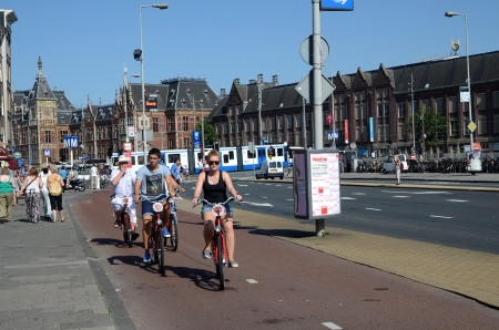 Amsterdam Holland August 2012:A group of tourists exploring Amsterdam by bike.