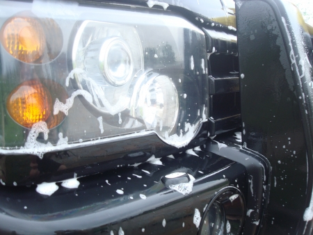 Car headlight in the foam photo