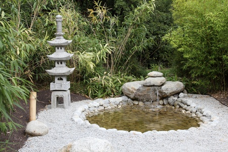 details of a japanese garden with pond and lantern Stock Photo