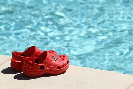 red sandals at poolside