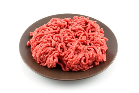 minced beef: details of ground meat in plate isolated on white Stock Photo