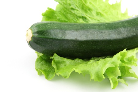 details of a fresh zucchini isolated on white on salad