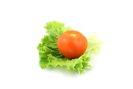 details of a tomato on salad isolated on white