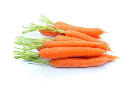 details of fresh carrots isolated on white