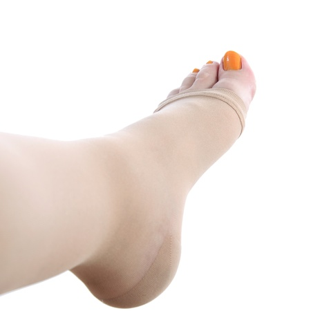 details of a foot of a pregnant woman with a compression stocking