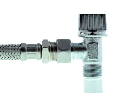 details of a water tap connecting with a hose flexible connector on white photo