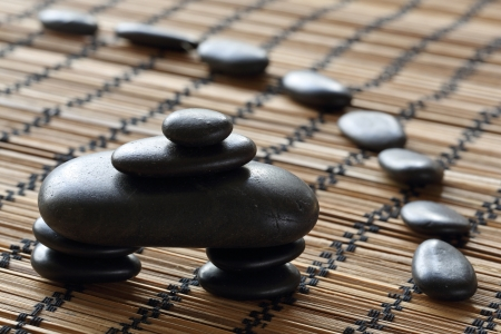 withe: details of a tranquil scene, made withe stack of black pebbles.