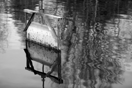 sluice: Details of a sluice of a pond in in Dombes in the department of Ain in France. Stock Photo