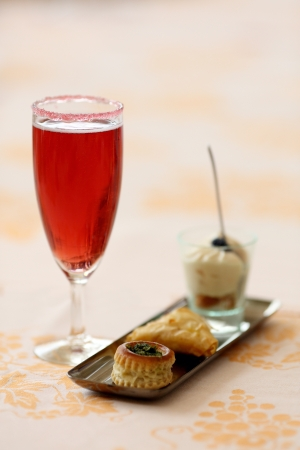amuse: Details of a glass of kir royal and amuse bouche  Stock Photo