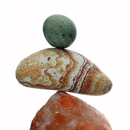 Details of a stone balance isolated on white background.