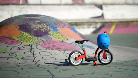 Details of a balance bicycle at the skate park with helmet.