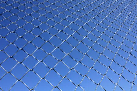 rabitz: Isolated Rabitz wire netting in clear blue sky background Stock Photo