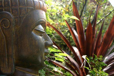 eastern philosophy: Serenity - Buddha in garden