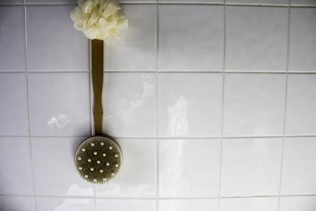 brush hanging against white tiles Stock Photo - 17691226