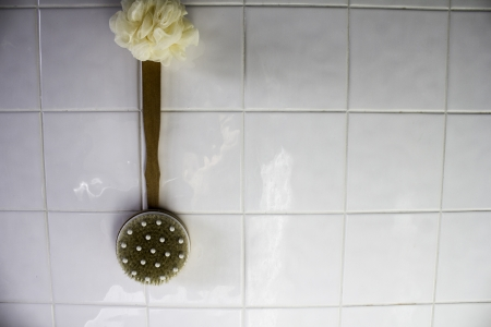 brush hanging against white tiles Stock Photo - 17691226