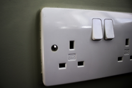 UK wall socket three-pin photo