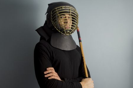 An eskrimador with stick and protective helmet Stock Photo - 17725528