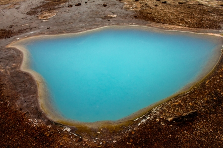 A beautiful blue pool of water in the geothermal surroundings of Iceland photo