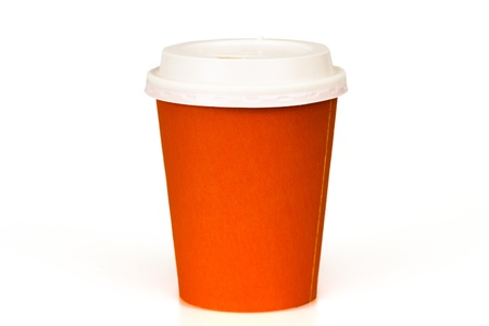 Orange paper cup isolated on white photo