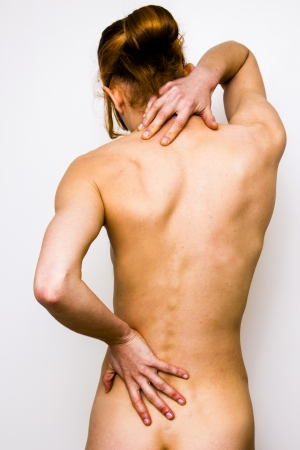 young woman with back and neck pain Stock Photo - 19761446