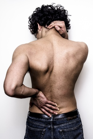 young man with back and neck pain Stock Photo - 19795613