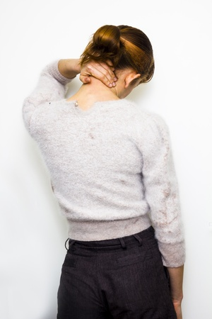 Young woman with neck pain photo