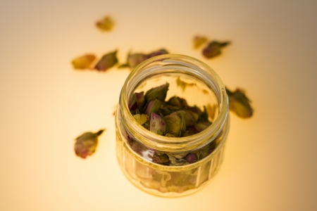 Dried rosebuds in a glass jar photo