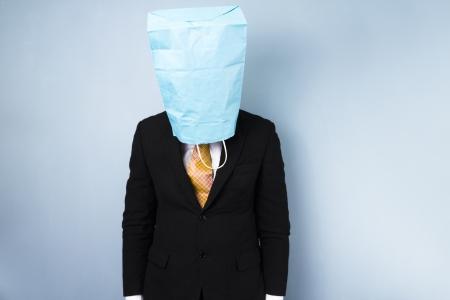 ashamed: Avergonzado negocios con bolsa en la cabeza Foto de archivo