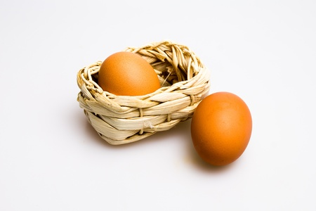 Two eggs and basket Stock Photo - 20164998