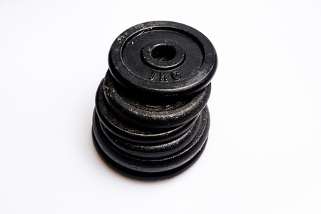 Stack of dumbbell weight discs Stock Photo - 20165004