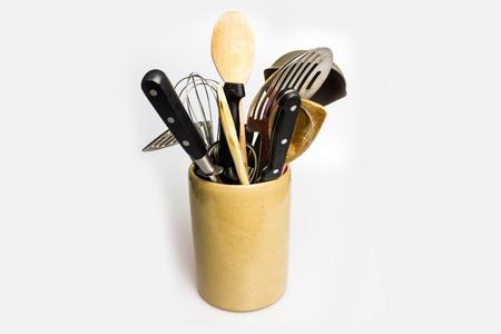 Various kitchen utensils in ceramic container photo