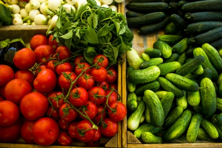 courgettes: Courgettes, tomatoes, onions, peppers and basil at the market